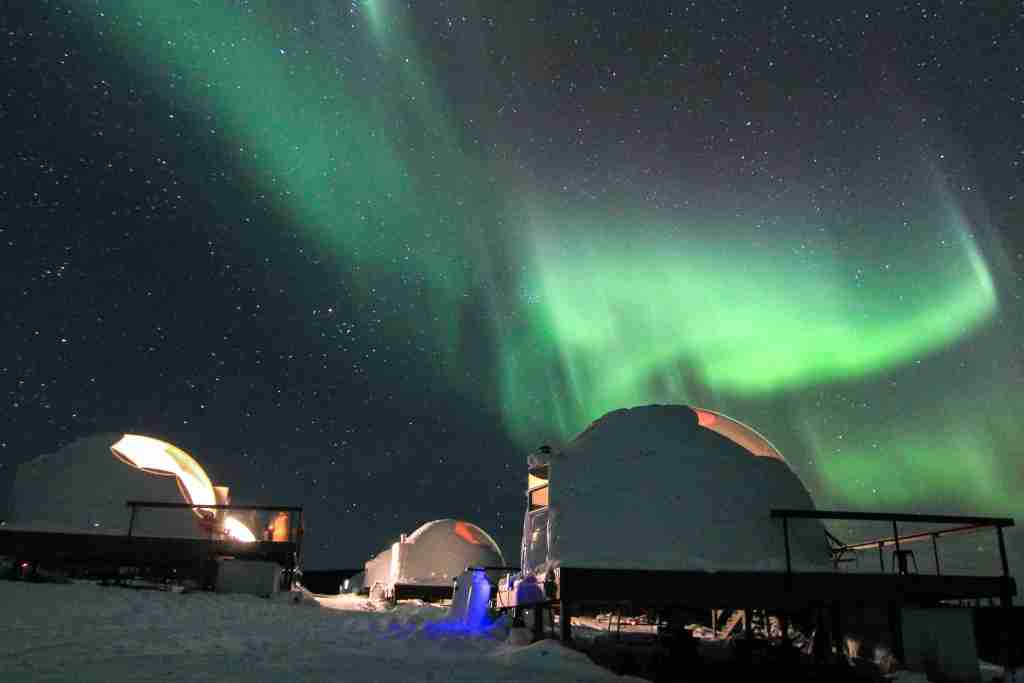 Stay in one of the glass domes at Borealis Basecamp with your family for a chance to see the Northern Lights from bed (Borealis Basecamp)