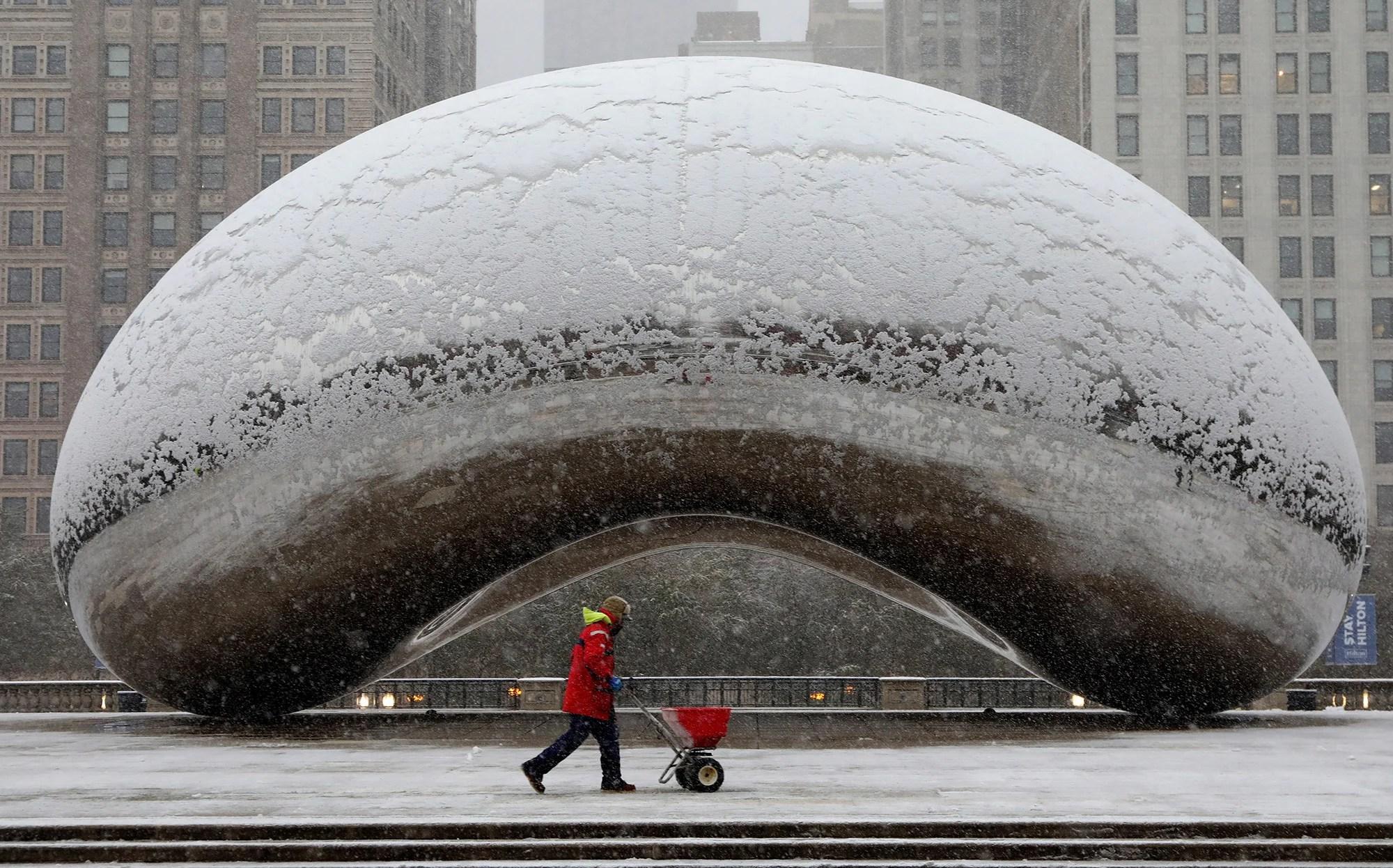Regional jet slides off Chicago runway as snow snarls travel