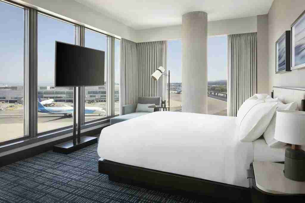 Guest room with a view of the tarmac at the Grand Hyatt