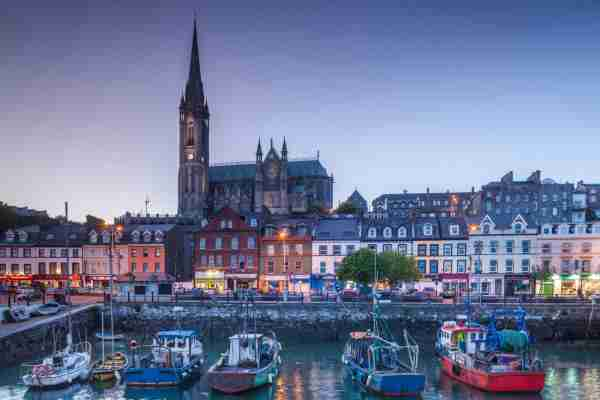 St. Colman's Cathedral from Cobh Harbor. (Photo by Walter Bibikow/Getty Images)