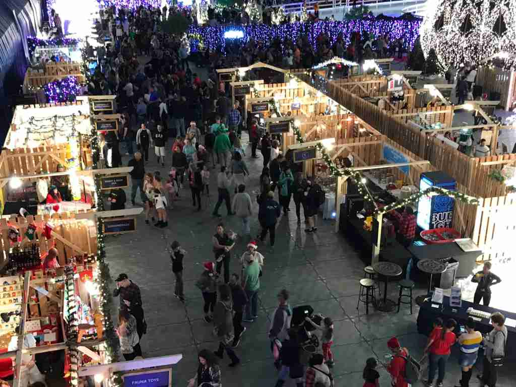 The holiday market is a warren of wooden stalls selling toys, gourmet bites and more (Terry-Ward.com)