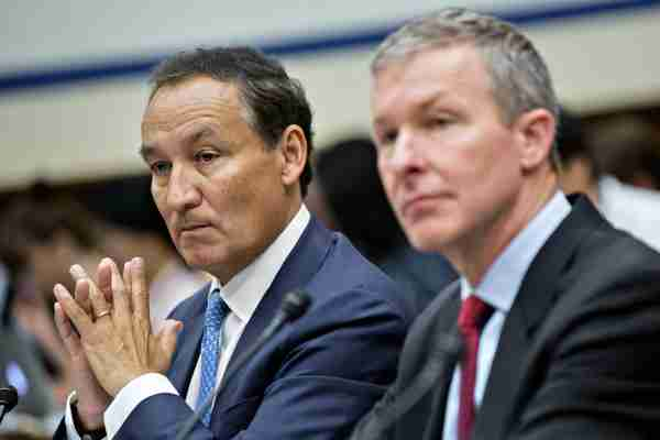 Oscar Munoz, chief executive officer of United Continental Holdings Inc., left, and Scott Kirby, president of United Continental Holdings, listen during a House Transportation and Infrastructure Committee hearing in Washington, D.C., U.S., on Tuesday, May 2, 2017. Munoz faces the House panels grilling over the violent removal of a passenger from an overcrowded United flight in whats become a familiar Capitol Hill ritual, the rhetorical flogging of executives for corporate misbehavior. Photographer: Andrew Harrer/Bloomberg via Getty Images