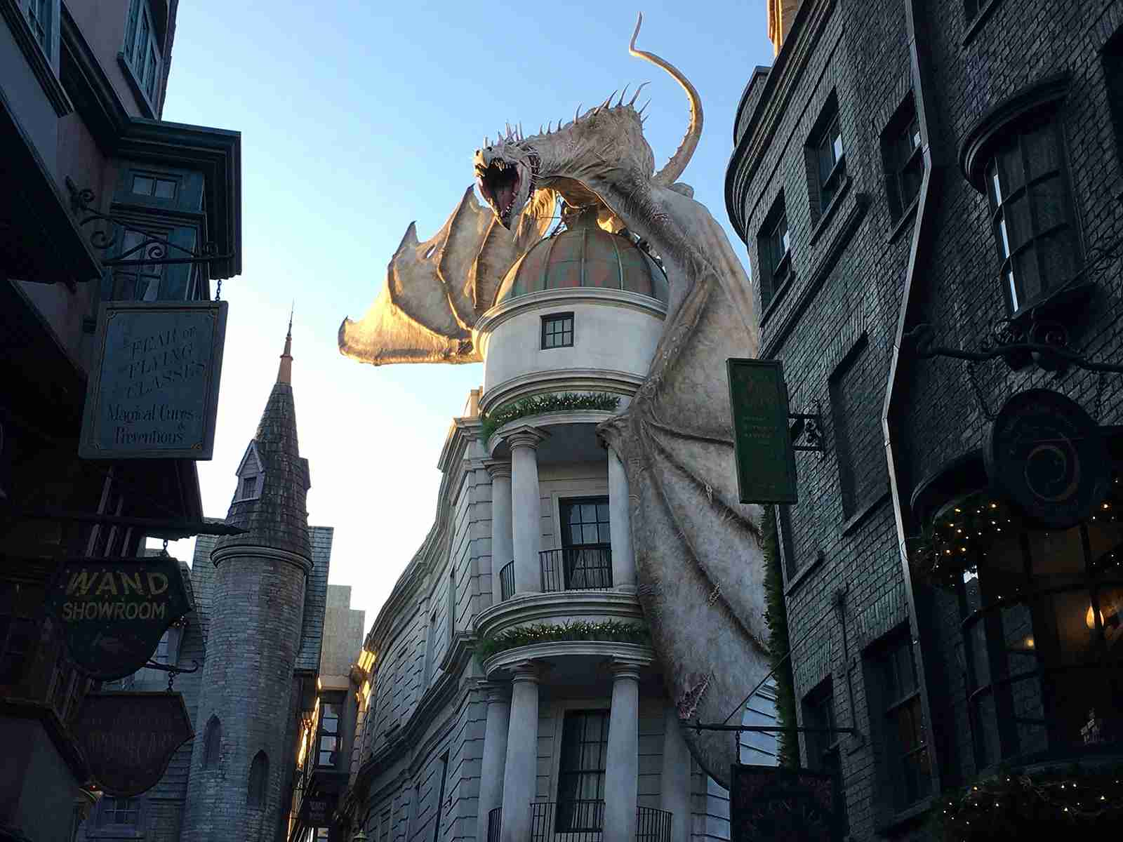 The dragon atop Gringotts breathes fire several times a day. (Photo by Andrea M. Rotondo/The Points Guy.)