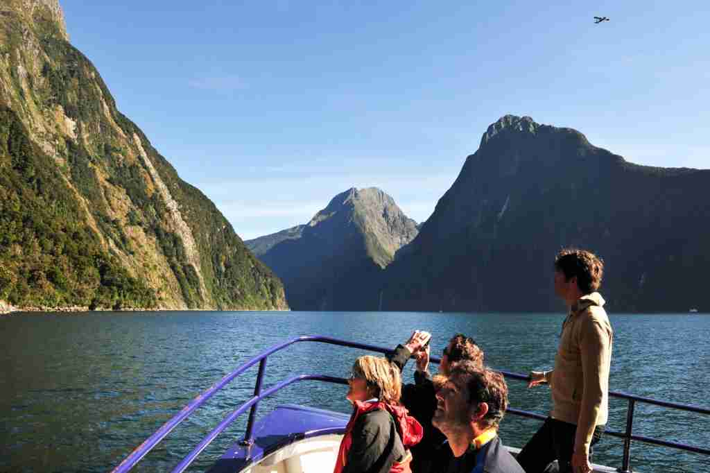 Take a boat ride through Fiordland National Park to sightsee. (Photo via Shutterstock)