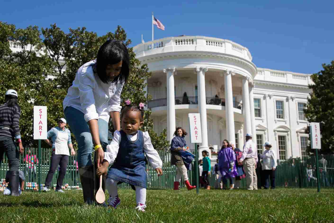 WASHINGTON, DC - MARCH 28: One year-old Ava Johnson plays a game during the annual White House Easter Egg Roll on the South Lawn of the White House March 28, 2016 in Washington, DC. The tradition dates back to 1878 when President Rutherford B. Hayes allowed children to roll eggs on the South Lawn. (Photo by Drew Angerer/Getty Images)