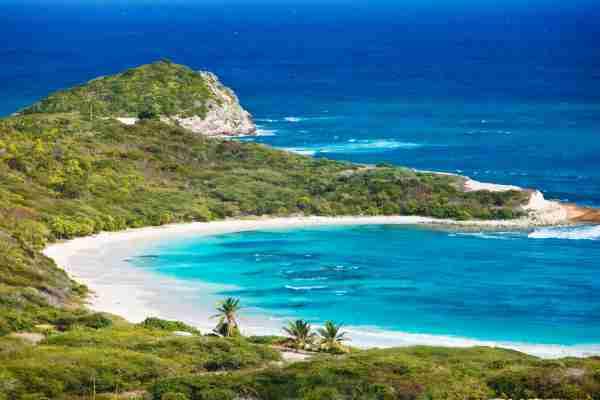 Half Moon Bay, Antigua.  (Photo from IndustryAndTravel / Shutterstock)