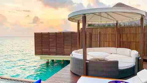 W Maldives overwater villa with pool and cabana