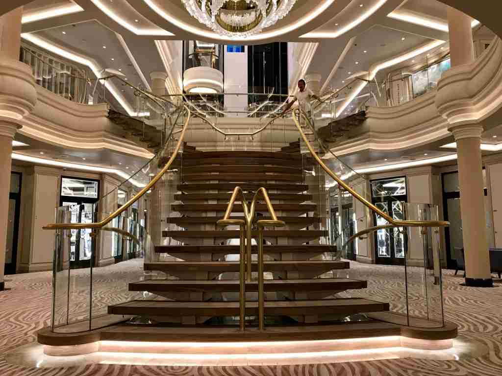The sweeping staircase at the center of Seven Seas Splendor faces the opposite way of the staircase on sister ship Seven Seas Explorer. (Photo by Gene Sloan/The Points Guy)