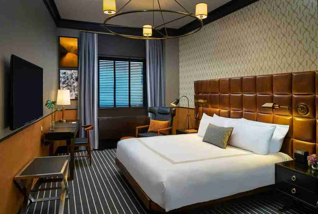 Rooms at Gild Hall have a cool, clubby feel. (Photo courtesy of Booking.com)