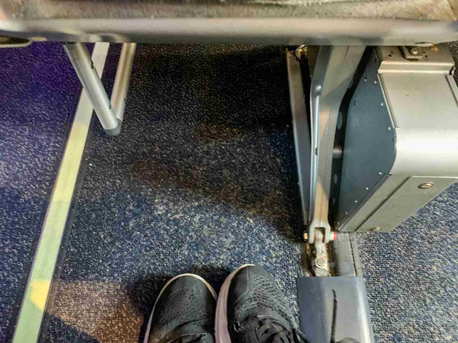 Limited foot space on Alaska Airlines coach seat. (Photo by Clint Henderson/The Points Guy)