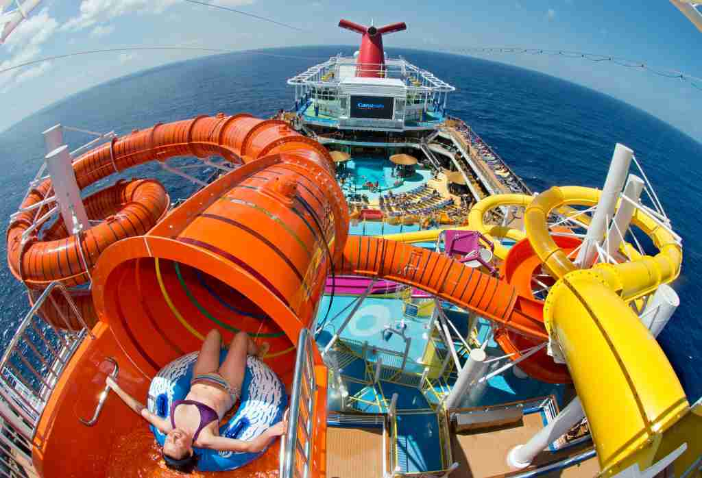 A passenger on Carnival Cruise Line's Carnival Vista prepares to slide down the ship's Kaleid-O-Slide. The water tube attraction is part of the vessel's WaterWorks waterpark area. (Photo by Andy Newman/Carnival Cruise Line)