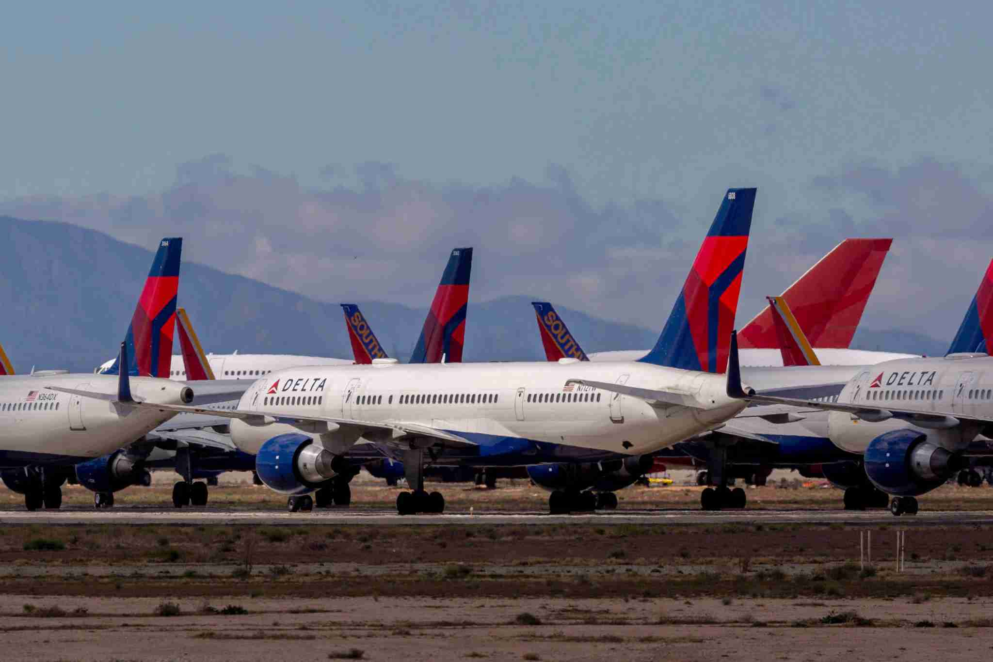 VICTORVILLE, CA - MARCH 24: Delta Air Lines jets are parked in growing numbers at Southern California Logistics Airport (SCLA) on March 24, 2020 in Victorville, California. As the coronavirus pandemic grows, exponentially increasing travel restrictions and the numbers of people in quarantine, airlines around the world are scrambling to find places to park a majority of their fleet as they wait to see how the situation will play out. (Photo by David McNew/Getty Images)