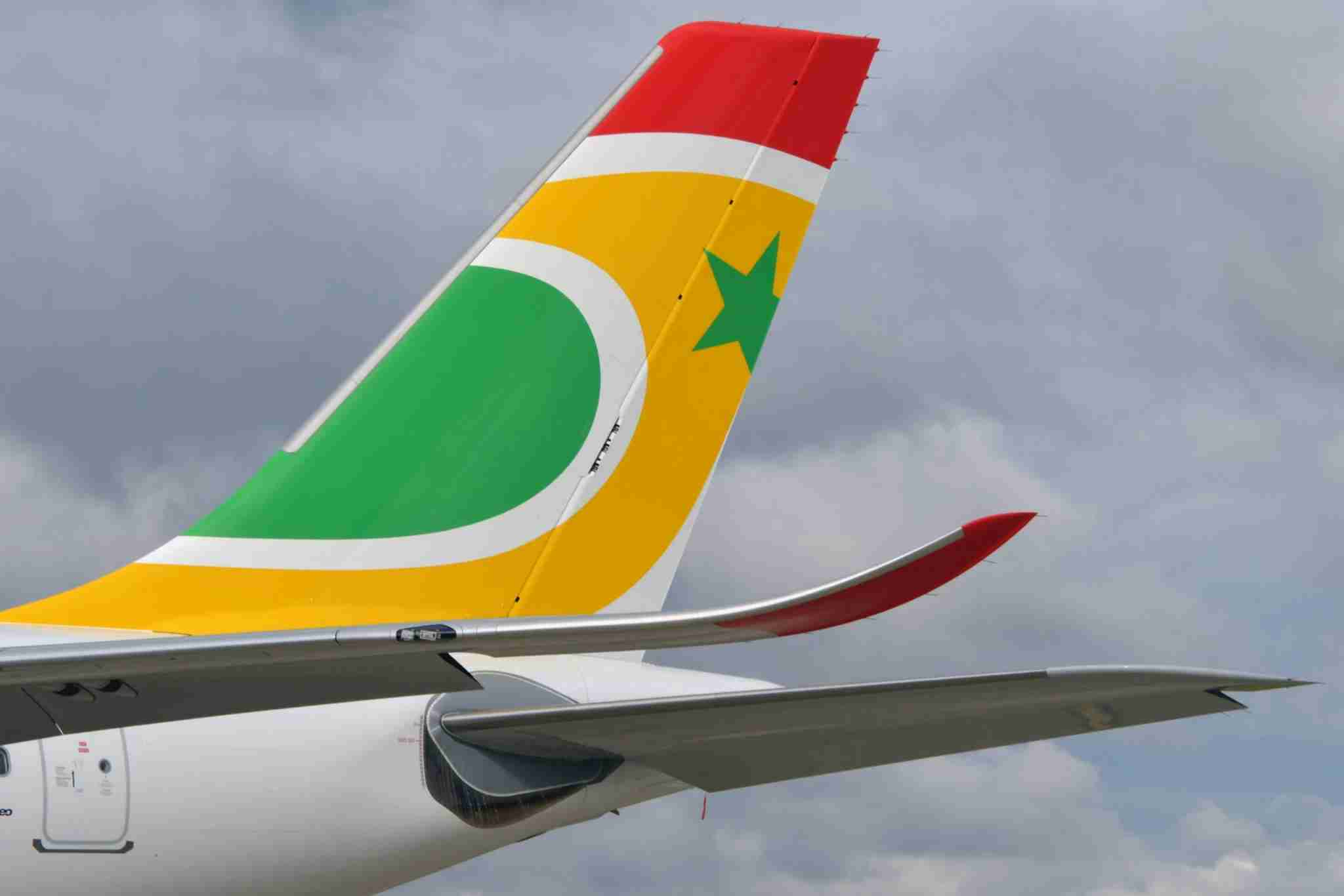 The tail of an Air Senegal Airbus A330-900 aircraft is seen at Airbus delivery center in France. The carrier planes to use another Airbus jet, its yet-to-be-delivered A321neos, to fly to London. (Photo by Pascal Pavani/AFP via Getty Images)