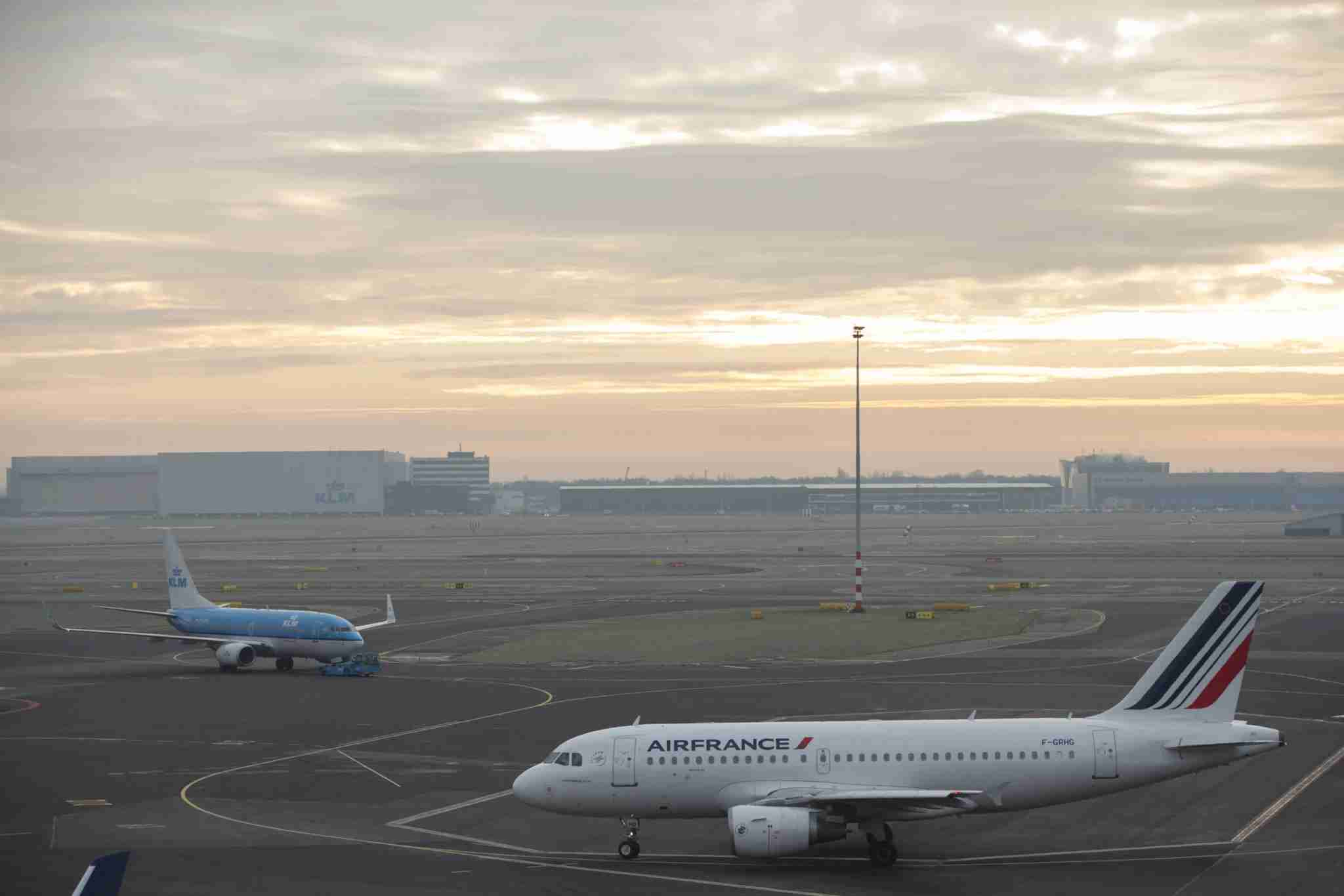 Passenger aircraft operated by Air France-KLM Group, right, and a KLM jet sit on the tarmac at Schiphol Airport, operated by the Schiphol Group, in Amsterdam, Netherlands, on Tuesday, Jan. 19, 2016. Air France-KLM Group, ranked as Europe