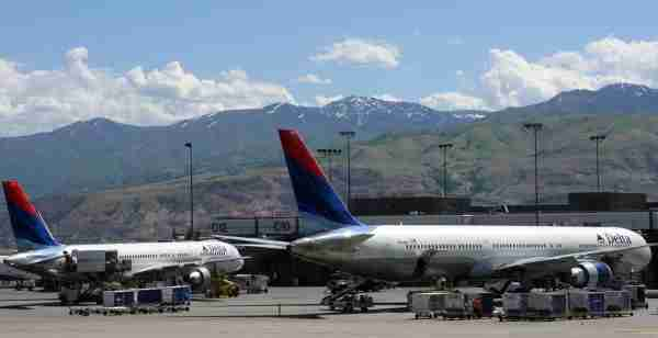 UNITED STATES - MAY 21: Delta Air Lines jets are seen at the Salt Lake International Airport, in Salt Lake City, Utah, Sunday, May 21, 2006. Delta Air Lines Inc. wants to terminate the pension plan for its 6,000 pilots, saying it needs the savings before it can exit bankruptcy protection. (Photo by Stephen Hilger/Bloomberg via Getty Images)