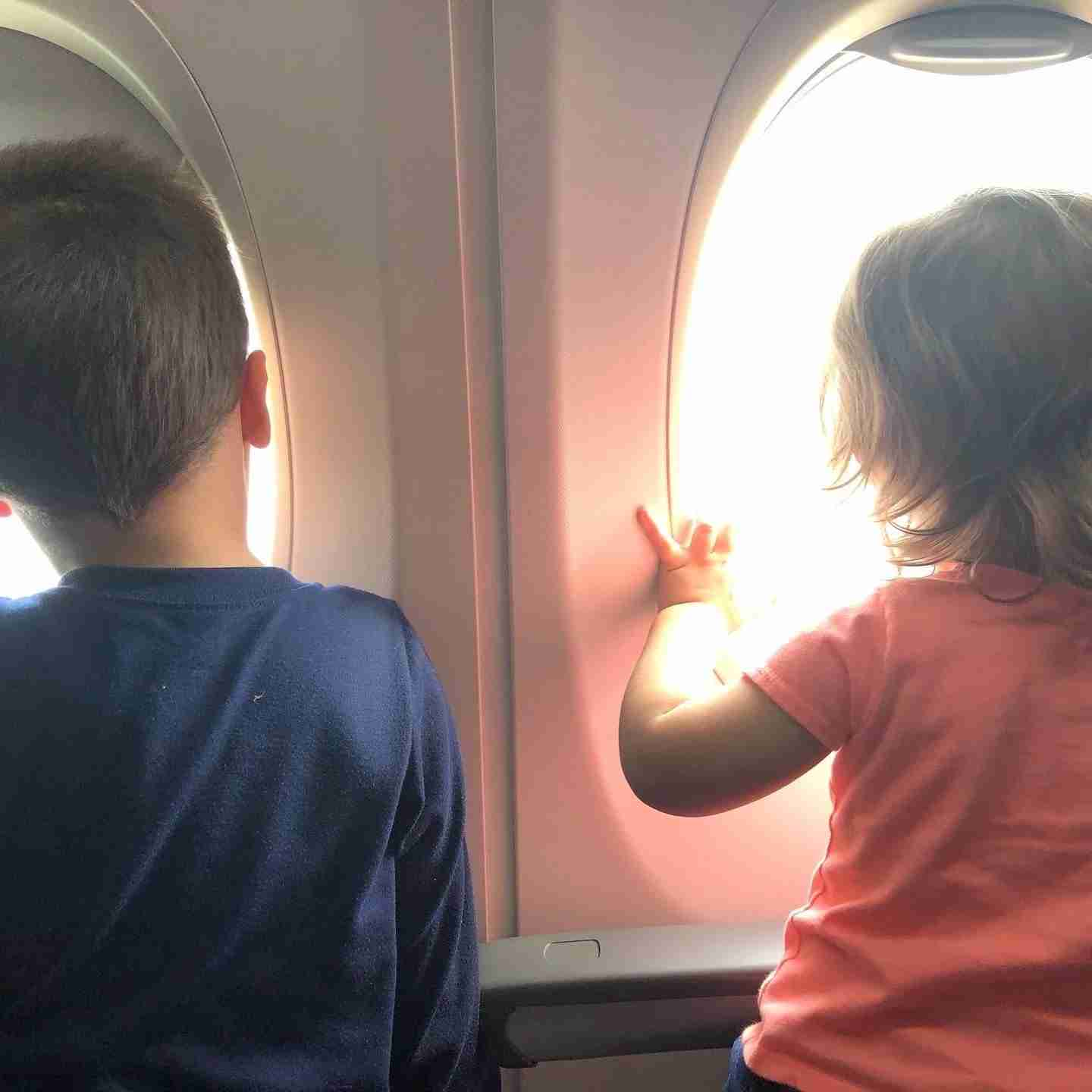 Oliver and Bryce on a REAL plane. (Photo by Casey Reid)