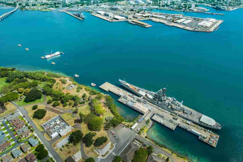 Aerial view of Arizona Memorial and Mighty Mo Missouri battleship at Pearl Harbor, Honolulu, Hawaii, USA. (Photo by Sean Davey / Auroroa Photos / Getty Images)