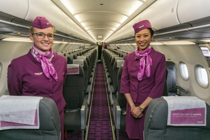 The friendly, helpful flight attendants on WOW Air wear these fun purple uniforms. Photo courtesy of WOW Air on Facebook.
