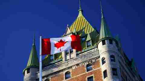 Canadian flag next to the Chateau Frontenac