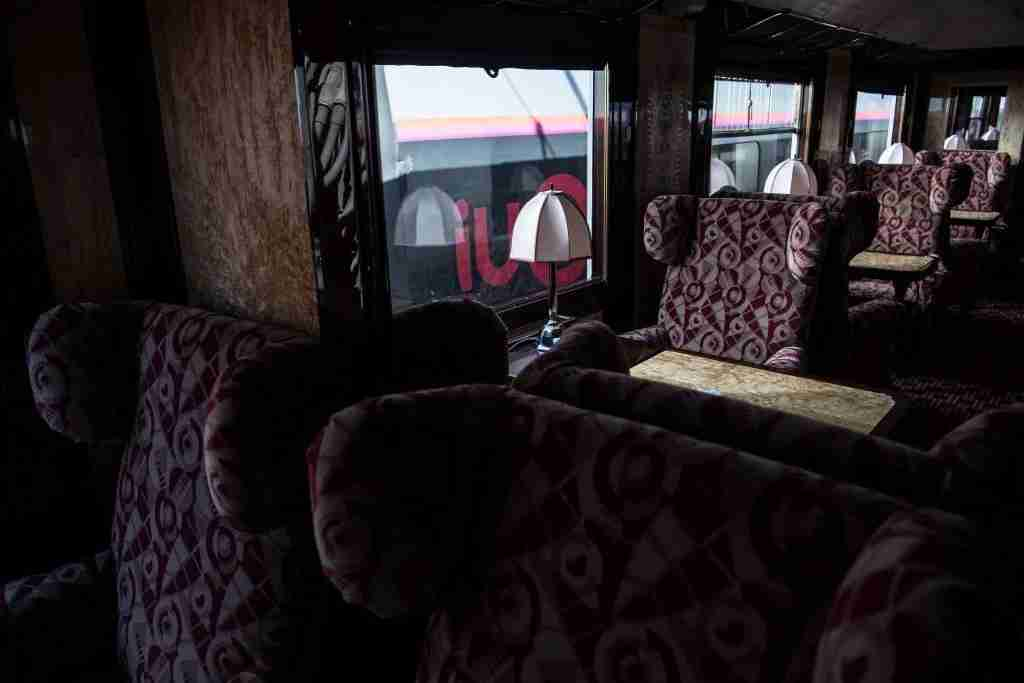 This picture taken on May 13, 2019 shows the interior of a newly-restored carriage of an Orient Express train displayed at the Gare de l
