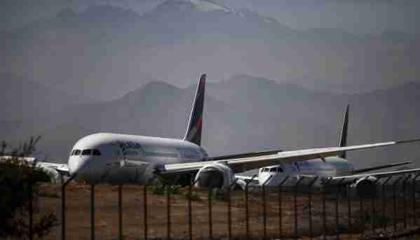 Aircrafts of Latam airline sit on the tarmac at Santiago International Airport, in Santiago, on March 24, 2020 during the new coronavirus, COVID-19, pandemic. - Chilean low-cost airline Sky announced on March 23 its was suspending all flights until May 1 due to the coronavirus pandemic and offered its aircrafts for carrying medical or humanitarian aid. Last week, Chilean-Brazilian airline Latam, the biggest in Latin America, announced a 70 percent reduction in its operations due to the same cause. (Photo by Martin BERNETTI / AFP) (Photo by MARTIN BERNETTI/AFP via Getty Images)