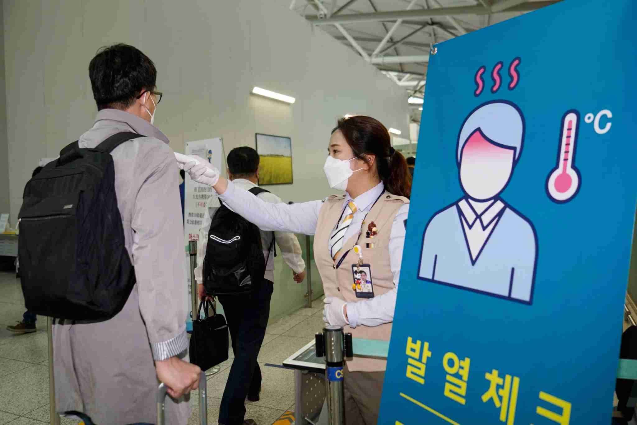 INCHEON, SOUTH KOREA - MAY 10: An employee of Samsung has his temperature checked before boarding a plane at Incheon International Airport on May 10, 2020 in Incheon, South Korea. More than 210 employees from South Korea