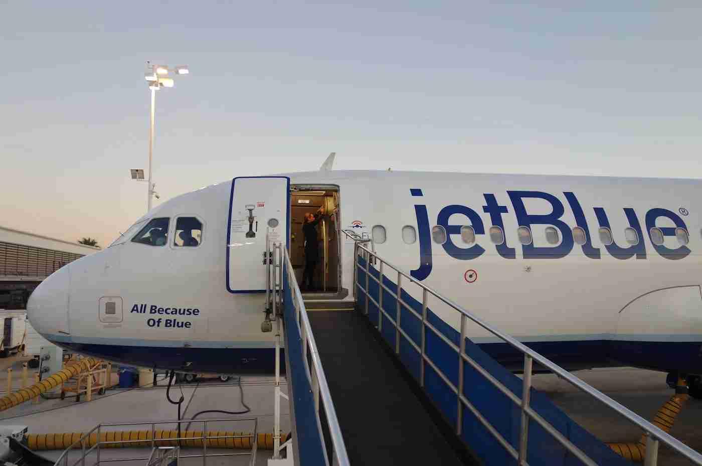 JetBlue plane with a jetbridge attached