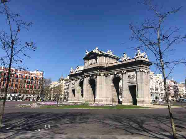 Normally busy 24/7, the traffic circle around Madrid's Puerta de Alcala is empty. (Photo by Carmen Hanson)