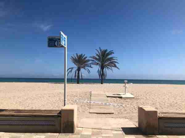 A cordoned-off beach in San Juan de Alicante. (Photo by Lori Zaino)