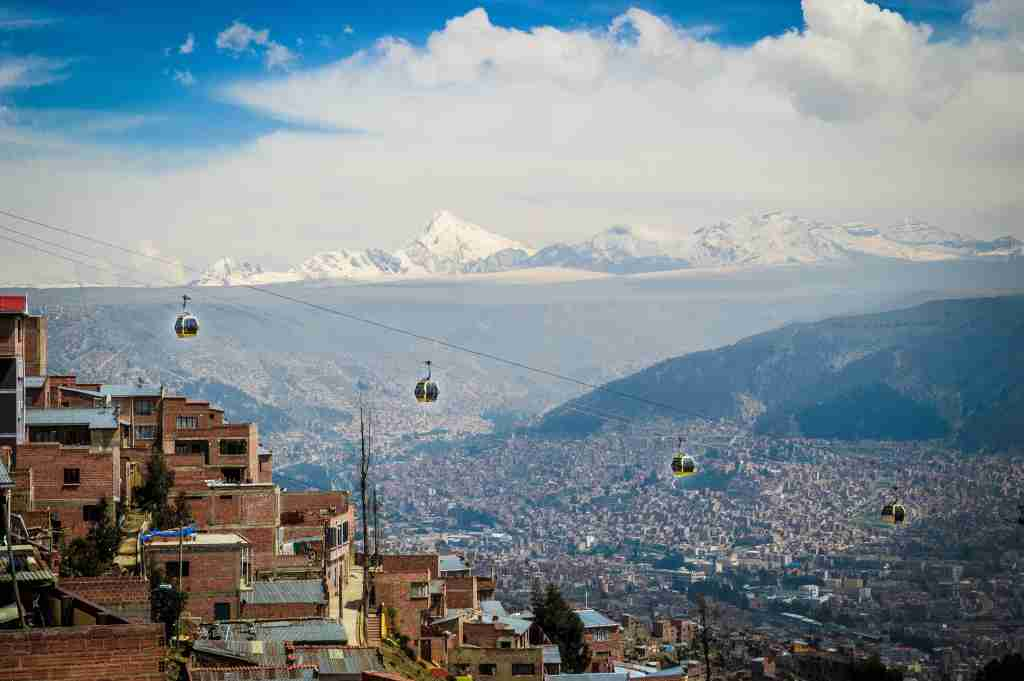 The teleferico in La Paz Bolivia with mountains in the background.