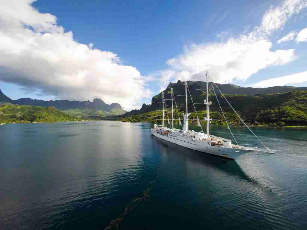 The 148-passenger Wind Spirit uses wind power to sail around the Society Islands of French Polynesia. (Photo courtesy of Windstar Cruises)
