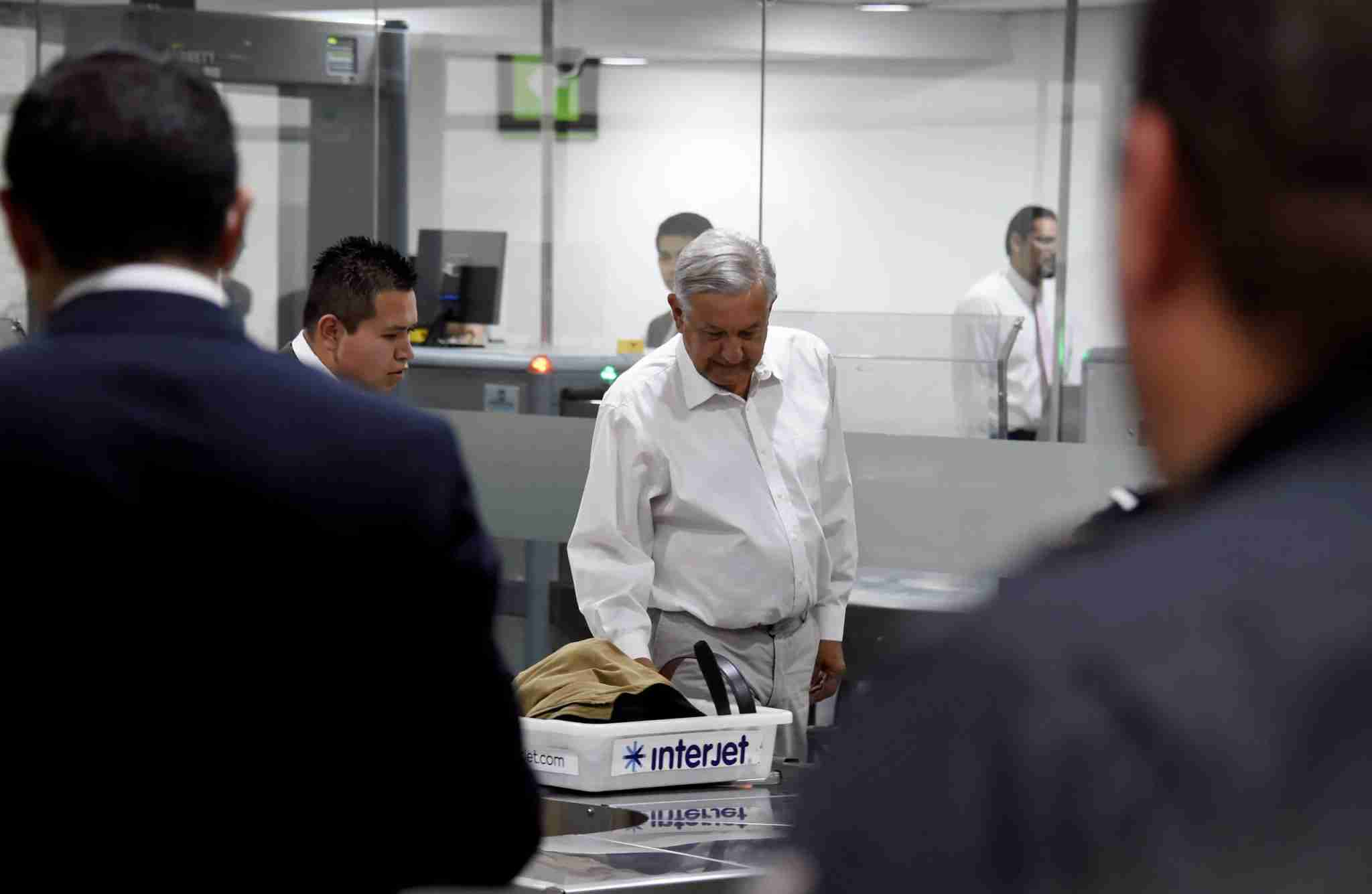 Mexican President Andres Manuel Lopez Obrador goes through the security area before boarding a commercial flight at Mexico City
