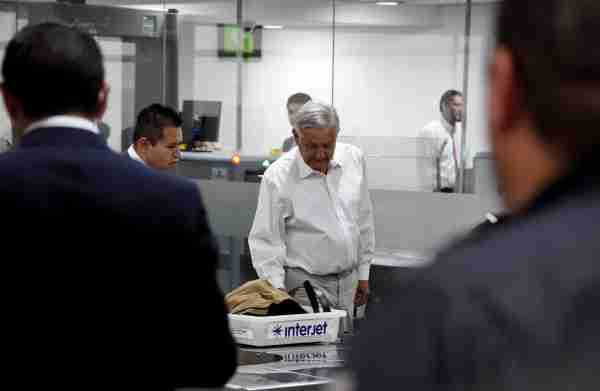 Mexican President Andres Manuel Lopez Obrador goes through the security area before boarding a commercial flight at Mexico City's international airport T2 on February 15, 2019. - Anti-establishment Lopez Obrador adpoted aggressive austerity measures for his government, including slashing his own salary, disbanding the presidential security detail and flying commercial airlines for official trips. (Photo by Alfredo ESTRELLA / AFP) (Photo credit should read ALFREDO ESTRELLA/AFP via Getty Images)