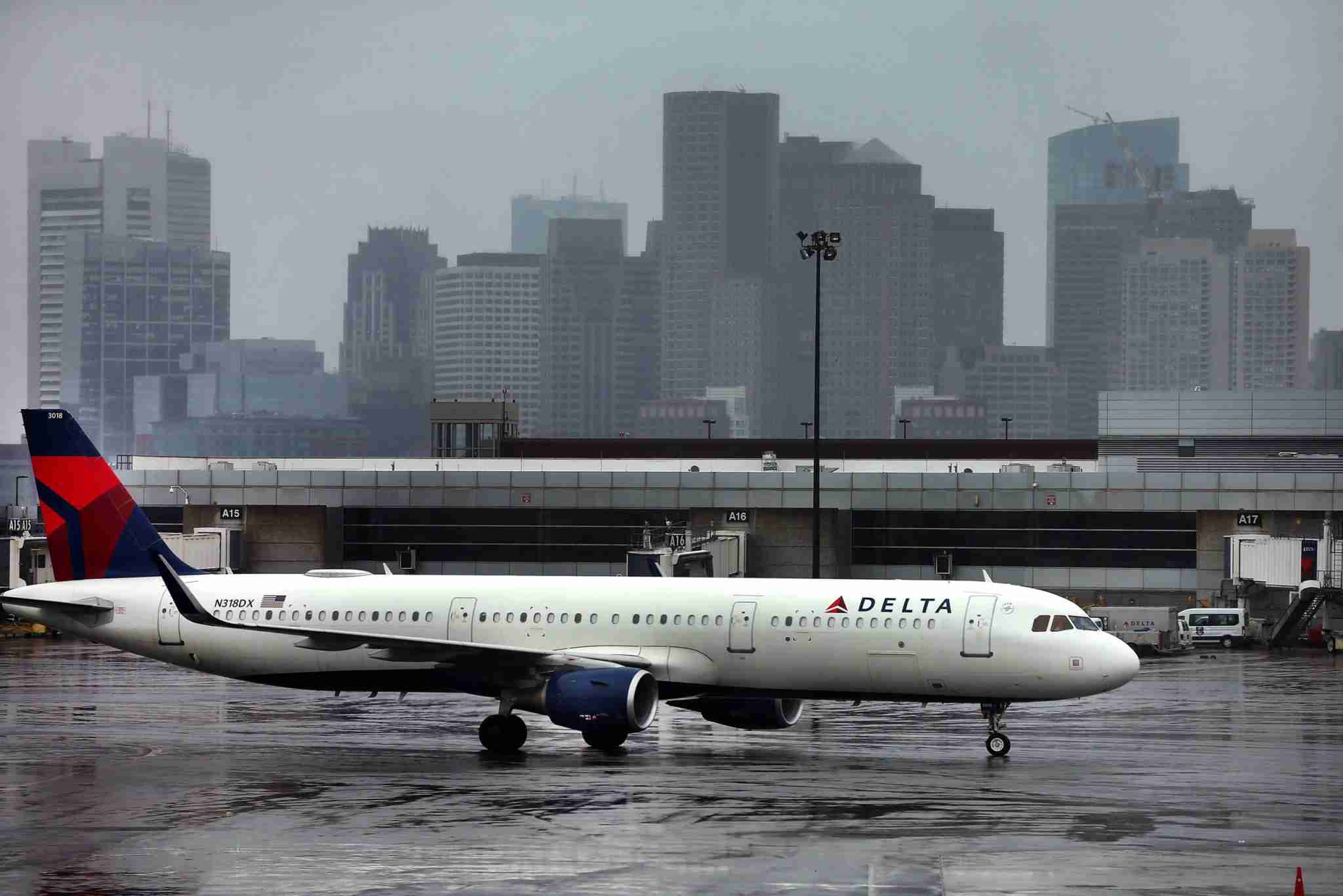 BOSTON, MA - APRIL 24: A Delta jet taxis to the gate at Boston Logan International Airport in Boston on April 24, 2020. (Photo by John Tlumacki/The Boston Globe via Getty Images)