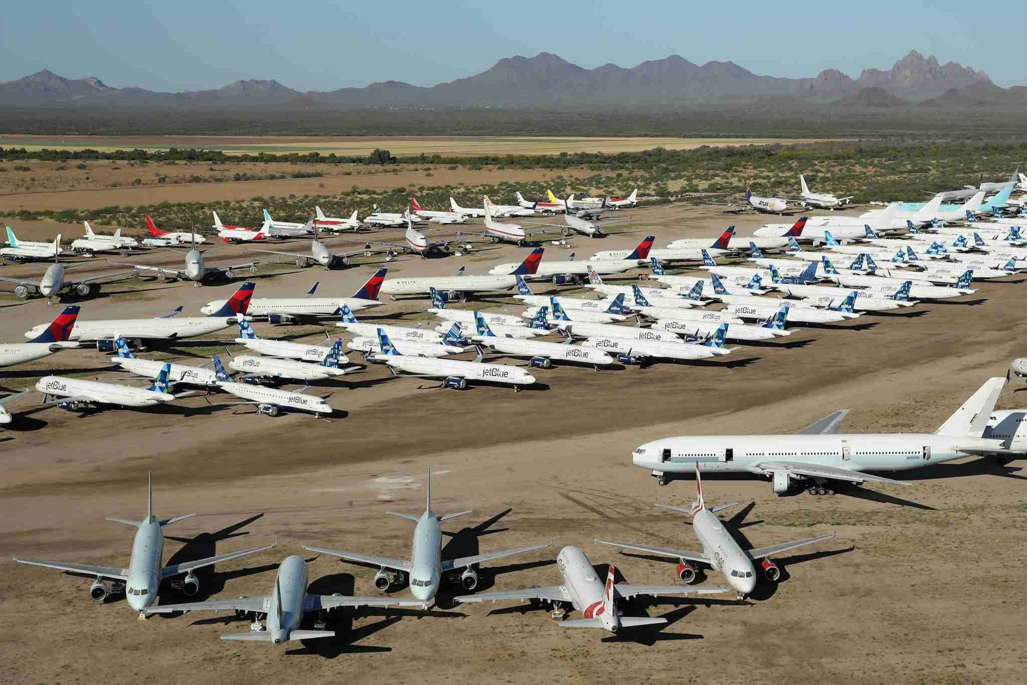 MARANA, ARIZONA - MAY 16: Decommissioned and suspended commercial aircrafts are seen stored in Pinal Airpark on May 16, 2020 in Marana, Arizona. Pinal Airpark is the largest commercial aircraft storage facility in the world, currently holding increased numbers of aircraft in response to the coronavirus COVID-19 pandemic. (Photo by Christian Petersen/Getty Images)