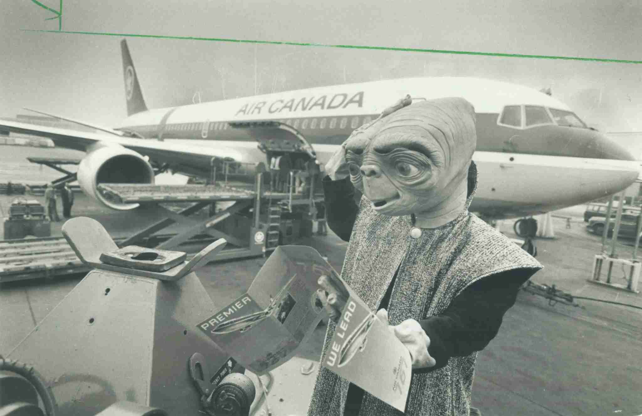CANADA - DECEMBER 02: World traveller: E. T. studies the information kit for Air Canada