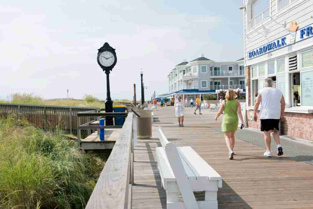 Visitors enjoy walks on the boardwalk at Bethany Beach. (Photo by Robert Kirk/Contributor/ Getty Images)
