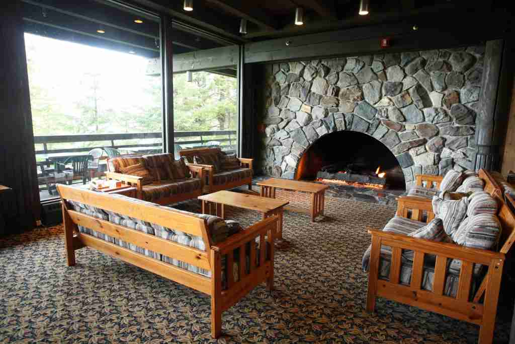 A large fireplace is a focal point inside the Glacier Bay Lodge. (Photo by Brian Adams courtesy of Travel Alaska).