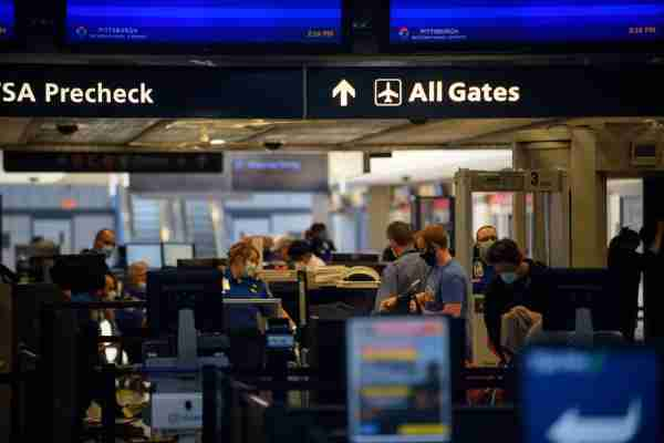 PITTSBURGH, PA - MAY 07: Travelers make their way through ticketing and TSA inspection as State of Pennsylvania remains under restrictions for work and travel at Pittsburgh International Airport on May 7, 2020 in Pittsburgh, Pennsylvania. (Photo by Jeff Swensen/Getty Images)