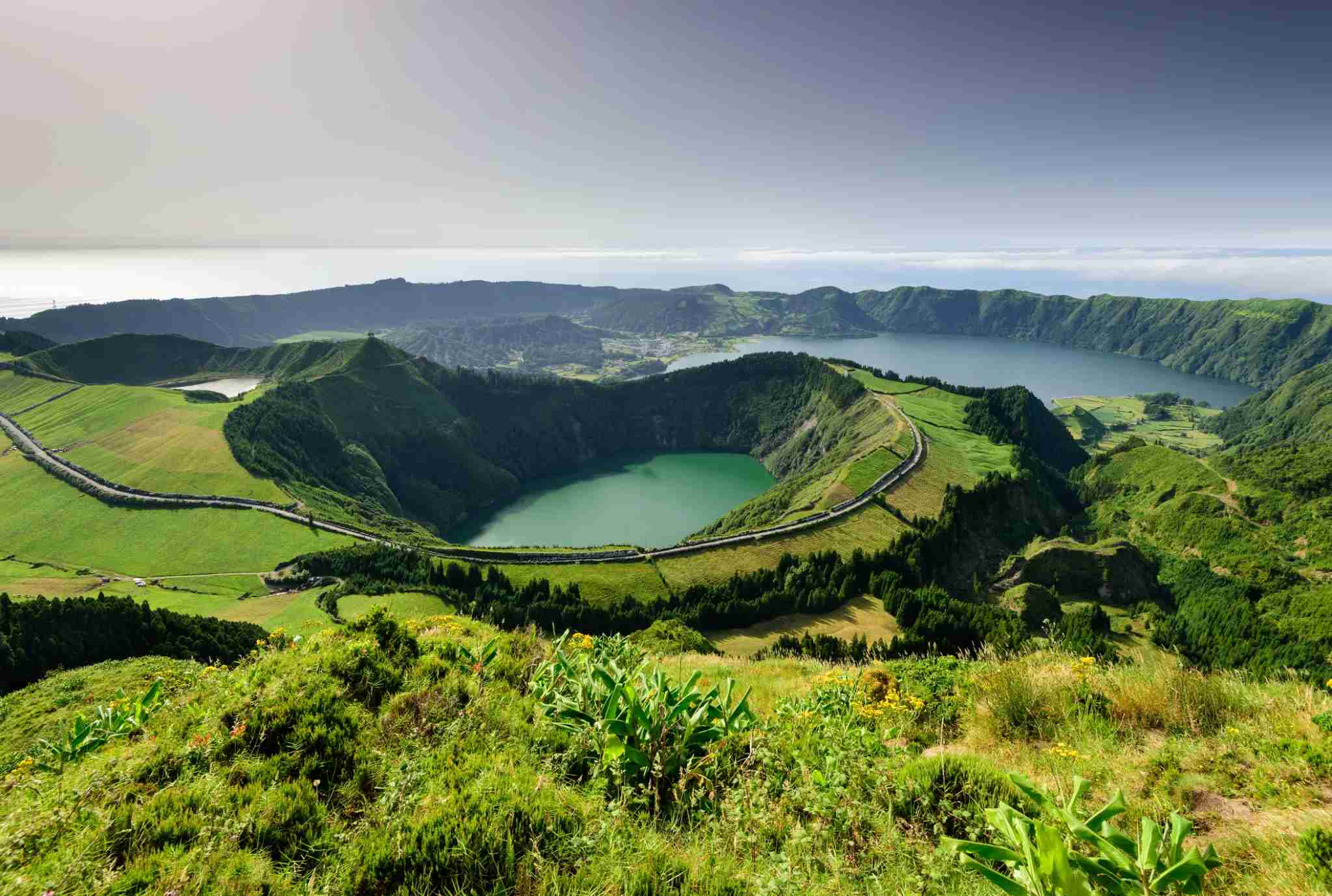 See sights like Santiago Lake, Rasa and lagoa Azul and Lagoa Seven Cities in the Azores. (Photo by ARoxo / Getty Images)