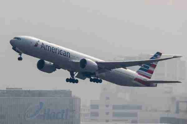 HONG KONG, HONG KONG - OCTOBER 23: A Boeing 777 passenger plane belonging to the American Airlines flies into the clouds after lifting off from Hong Kong International Airport, on 23 October 2017, in Hong Kong, Hong Kong. (Photo by studioEAST/Getty Images)