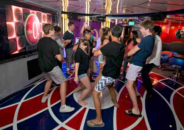 Teens dance to the sounds of a DJ at Club O2, a teen-only lounge found on Carnival ships. (Photo by Andy Newman courtesy of Carnival Cruise Line)