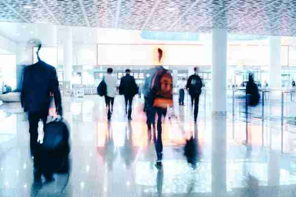 Motion Blur of People Walking in modern corridor with glass and steel (Photo by Nikada/Getty Images)