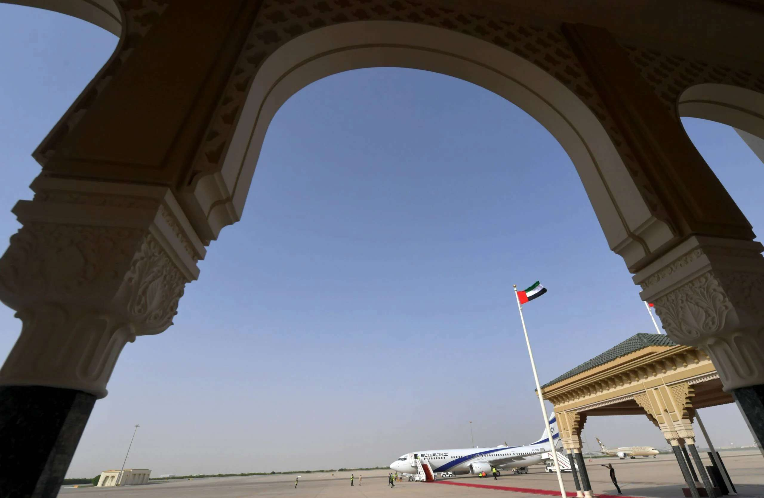 An El Al aircraft, which carried a U.S.-Israeli delegation to the UAE following a normalization accord, is pictured at the tarmac of the Abu Dhabi airport following the arrival of the first-ever commercial flight from Israel to the UAE on Aug. 31, 2020. (Photo by Karim Sahib/AFP via Getty Images)