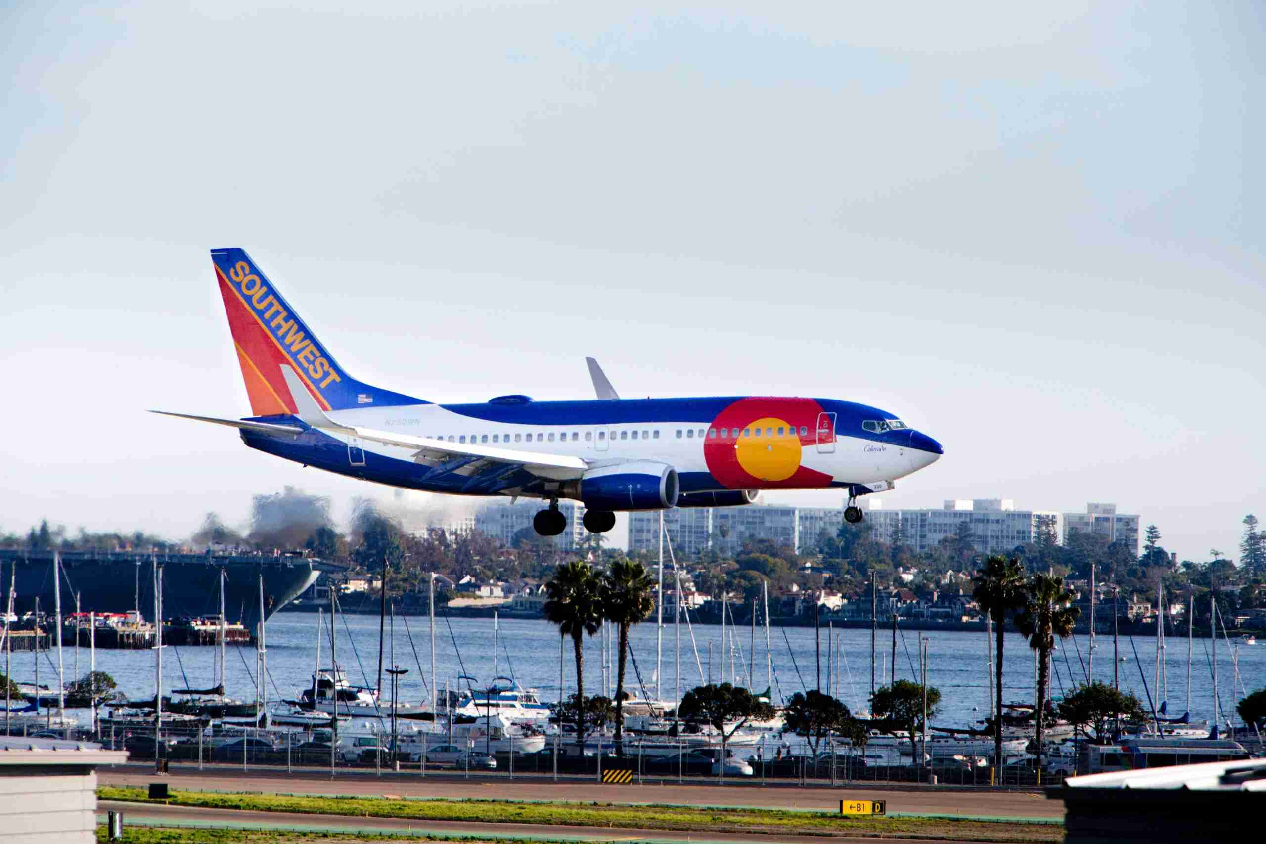 A Southwest Airlines jet wearing a special Colorado livery approaches San Diego