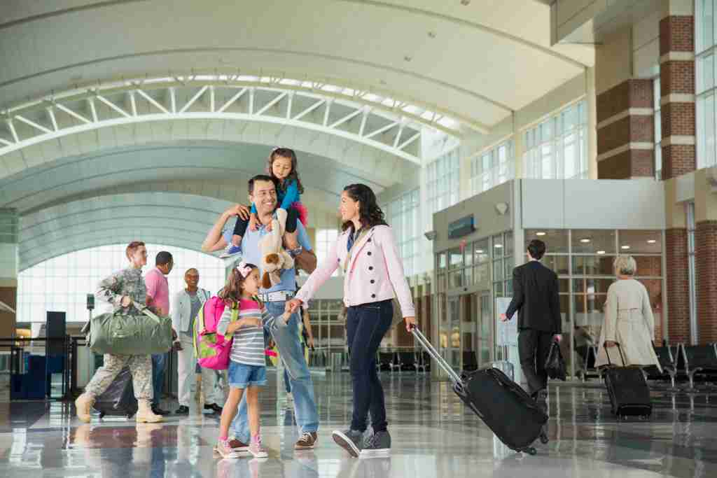 family with luggage airport