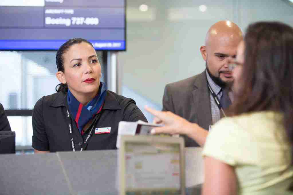 American Airlines gate agent helping customer
