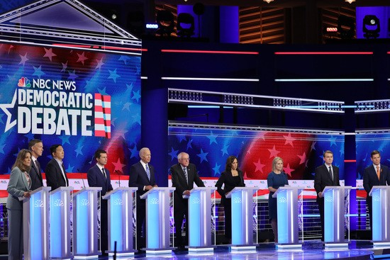 MIAMI, FLORIDA - JUNE 27: Democratic presidential candidates (L-R) Marianne Williamson, former Colorado governor John Hickenlooper, former tech executive Andrew Yang, South Bend, Indiana Mayor Pete Buttigieg, former Vice President Joe Biden, Sen. Bernie Sanders (I-VT), Sen. Kamala Harris (D-CA), Sen. Kirsten Gillibrand (D-NY), Sen. Michael Bennet (D-CO) and Rep. Eric Swalwell (D-CA) take part in the second night of the first Democratic presidential debate on June 27, 2019 in Miami, Florida. A field of 20 Democratic presidential candidates was split into two groups of 10 for the first debate of the 2020 election, taking place over two nights at Knight Concert Hall of the Adrienne Arsht Center for the Performing Arts of Miami-Dade County, hosted by NBC News, MSNBC, and Telemundo. (Photo by Drew Angerer/Getty Images)