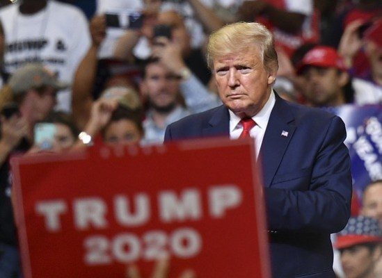 TOPSHOT - US President Donald Trump looks on during a rally at the Amway Center in Orlando, Florida to officially launch his 2020 campaign on June 18, 2019. (Photo by MANDEL NGAN / AFP) (Photo credit should read MANDEL NGAN/AFP/Getty Images)