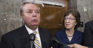 Sen. Lindsey Graham, R-S.C., from left, Sen. Susan Collins, R-Maine, and Sen. Jeff Flake, R-Ariz., speak to reporters after working with a bipartisan group of moderate senators to find a way to reopen the government on the third day the federal shutdown, at the Capitol in Washington, Monday, Jan. 22, 2018. (AP Photo/J. Scott Applewhite)